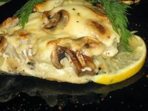 Рыба с грибами приготовленная в духовке